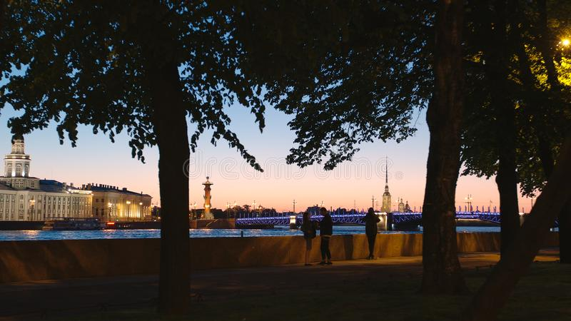 People on an embankment of the Neva river in the White Nights. ST. PETERSBURG, RUSSIA - JUNE 16, 2017: People on an embankment of the Neva river in the White stock photography