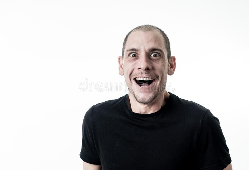 People emotions and facial expressions. Portrait of comic young man with funny crazy happy face royalty free stock images