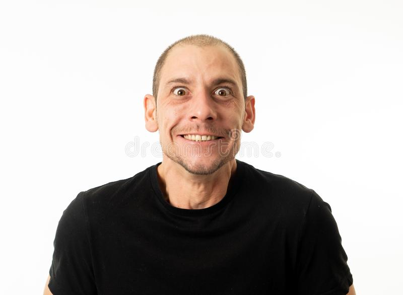 People emotions and facial expressions. Portrait of comic young man with funny crazy happy face stock photo
