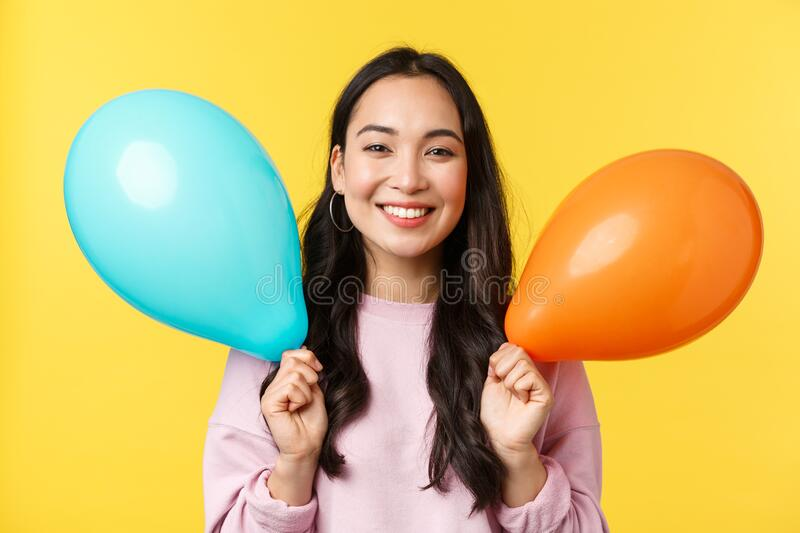 People emotions, lifestyle leisure and beauty concept. Happy cute asian birthday girl celebrating big event, holding stock photo