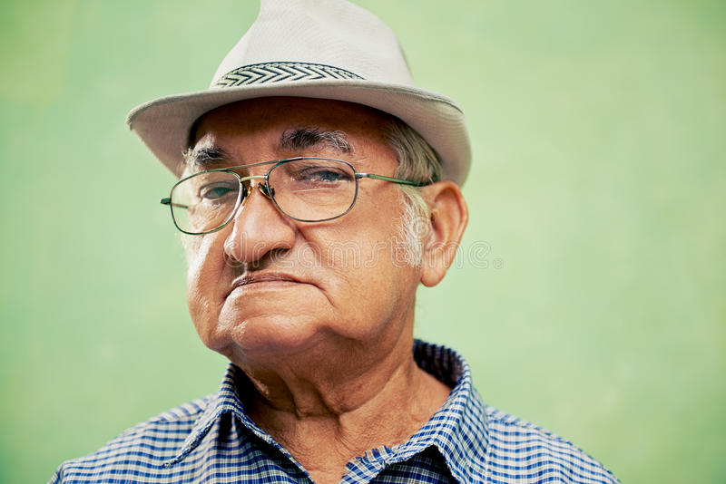 Download Portrait Of Serious Old Man With Hat Looking At Camera Stock Photo - Image: 29922742