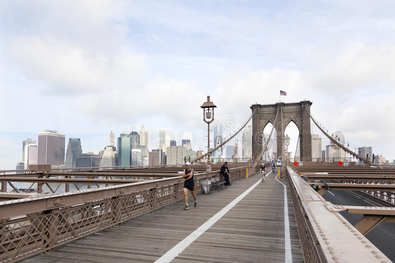 People Engaged In Bike Run And Running On Brooklyn Bridge ...