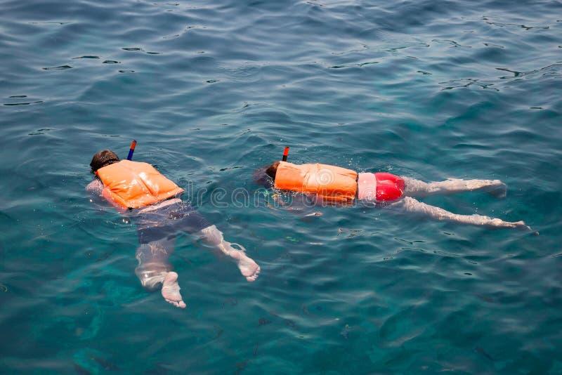 People engaged in snorkeling, Andaman Sea, coast Thailand. People engaged in snorkeling in life jackets. Phi Phi Islands, Andaman Sea, Thailand stock photos
