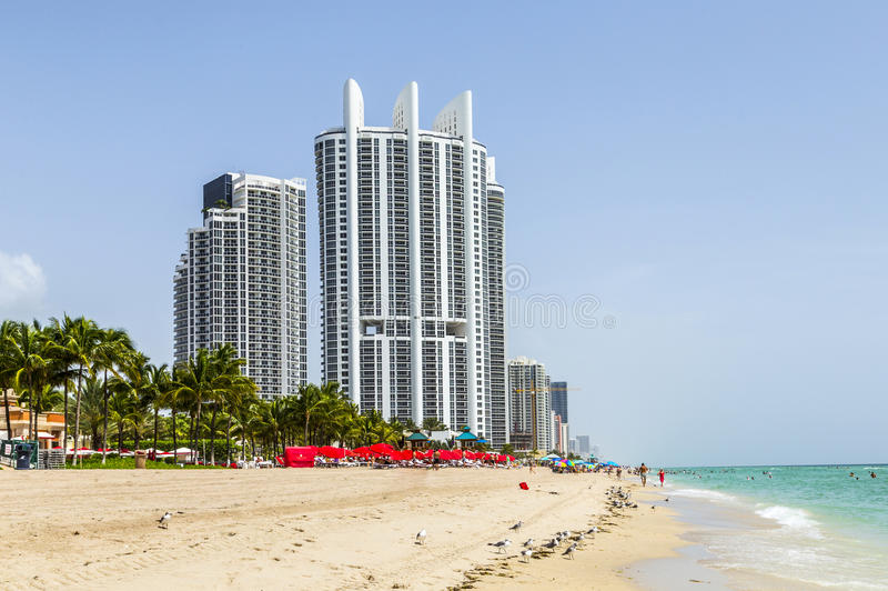 People enjoy the beach at Trump tower at Sunny isles beach stock images