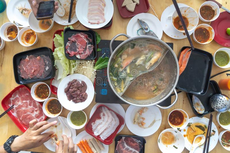 People enjoy eating Shabu Sukiyaki, Japanese food together top view stock image