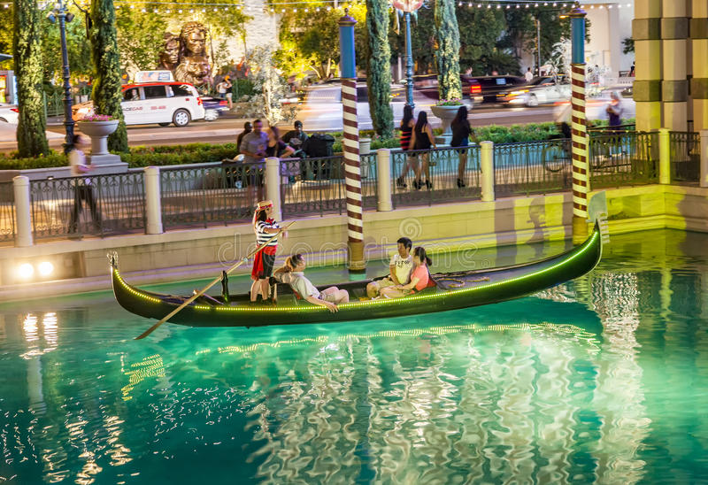 People enjoy the gondola at Venetian Resort Hotel & Casino stock images