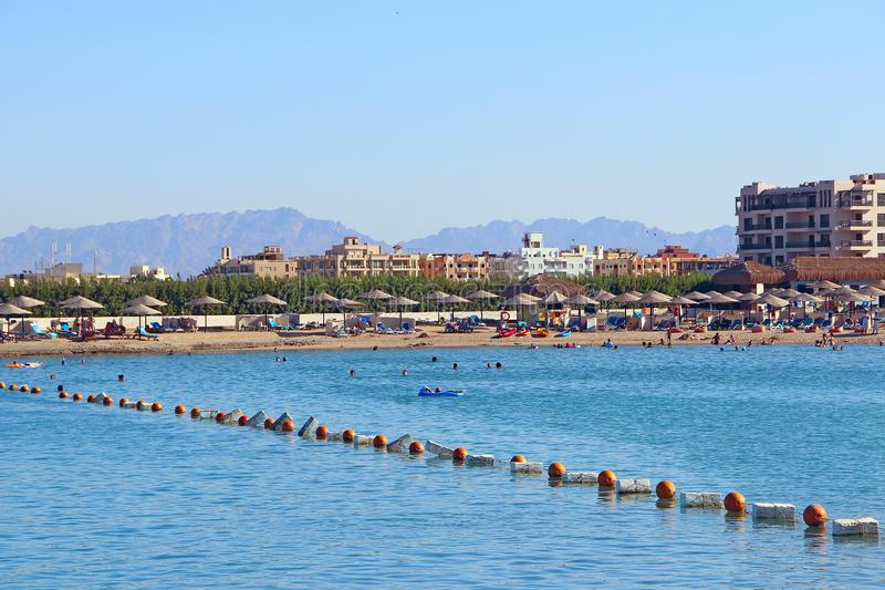 People enjoy holidays in Egyptian resort. Panorama with view of resort hotels royalty free stock image