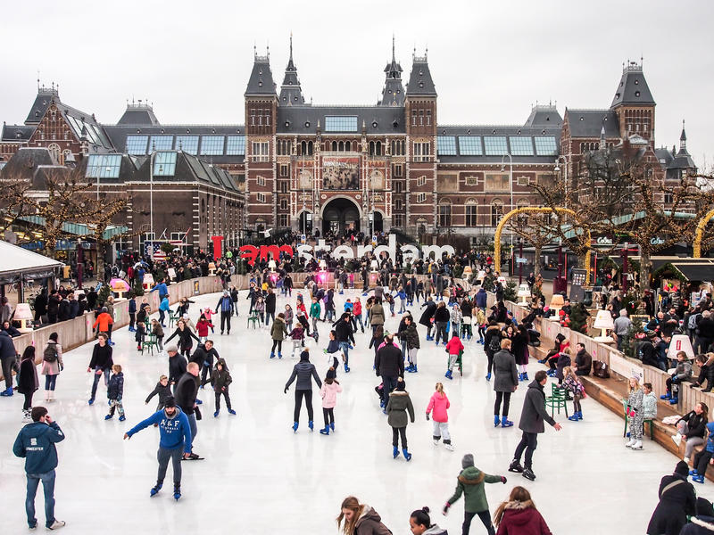 People enjoy ice skating in front of Rijksmuseum stock images