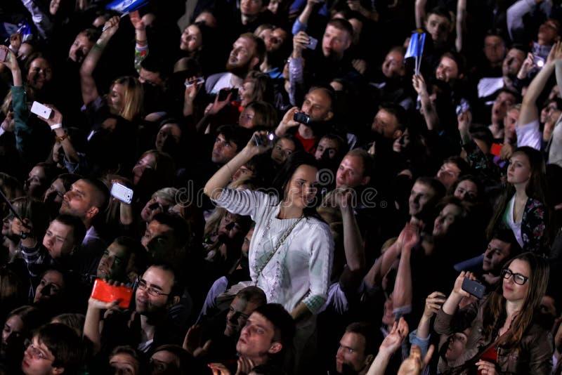 People enjoy rock-concert at a stadium stock photo