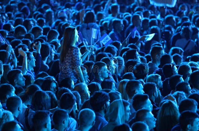 People enjoy rock-concert at a stadium royalty free stock photos