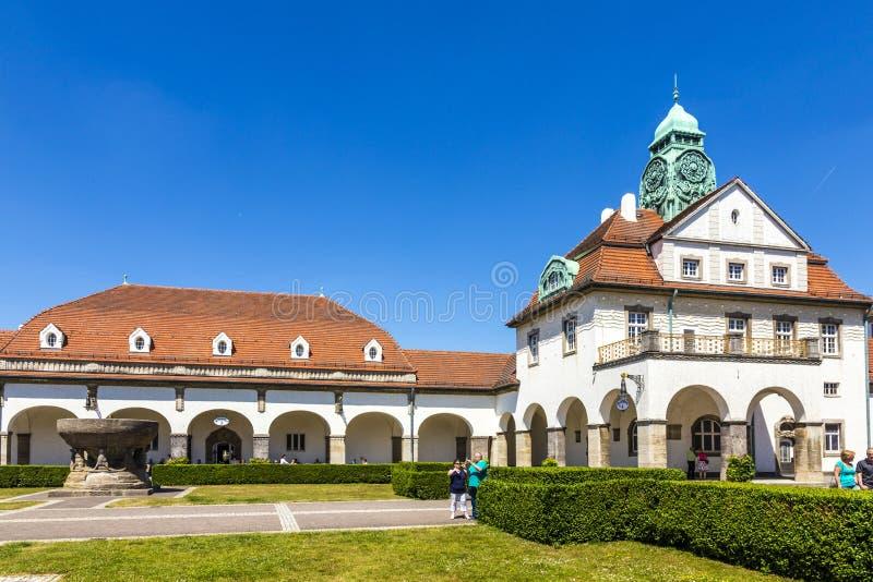 People enjoy the sun in the beautiful Sprudelhof in Bad Nauheim royalty free stock photo