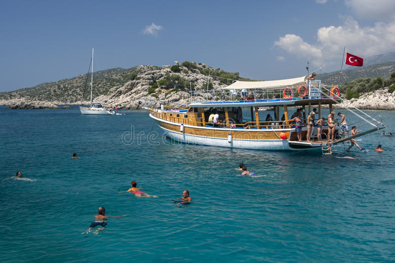 People enjoy swimming in the Mediterranean Sea after jumping off their cruise boat. stock photos
