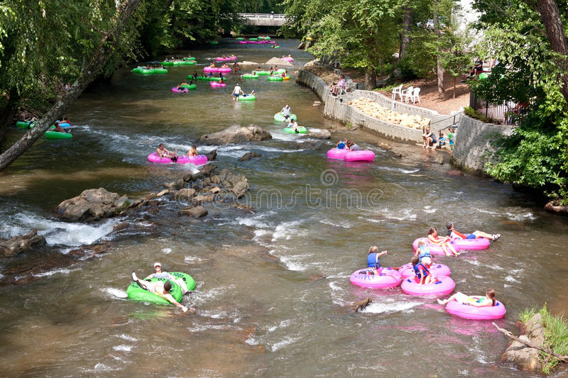People Enjoy Tubing Down North Georgia River royalty free stock images