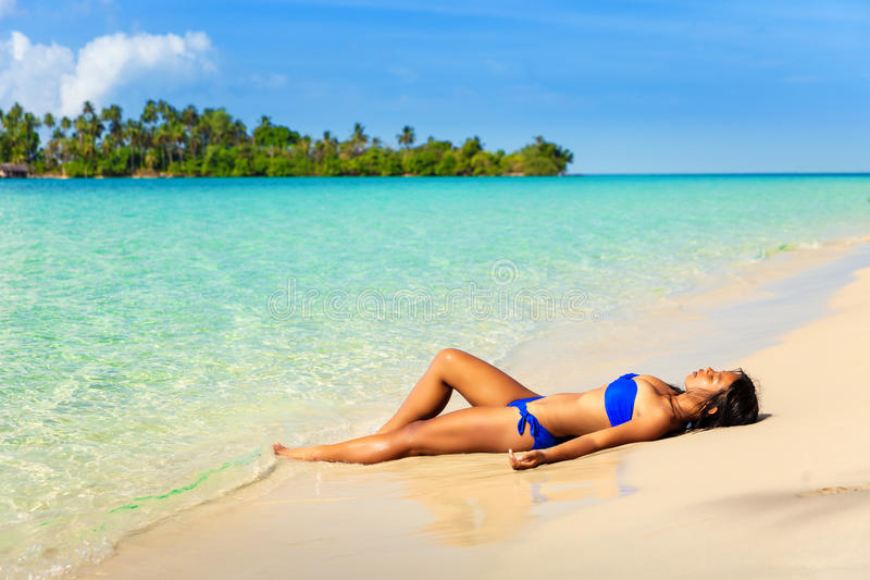 People Enjoy Vacation On Tropical Sandy Beach On Background Sea