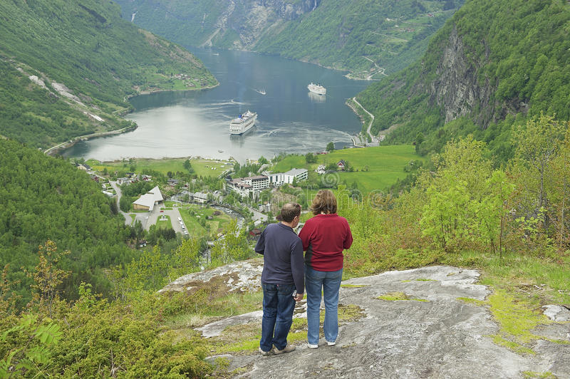 People enjoy the view to Geiranger fjord in Geiranger, Norway. stock photo