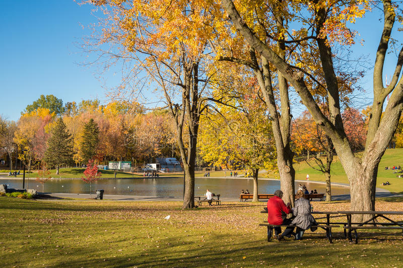 People enjoy a warm autumn day in Montreal royalty free stock photo