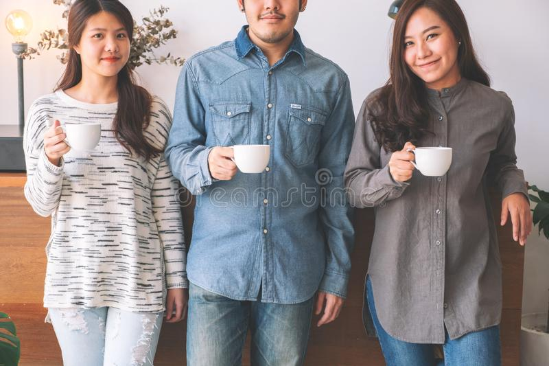 People drinking coffee together stock photo