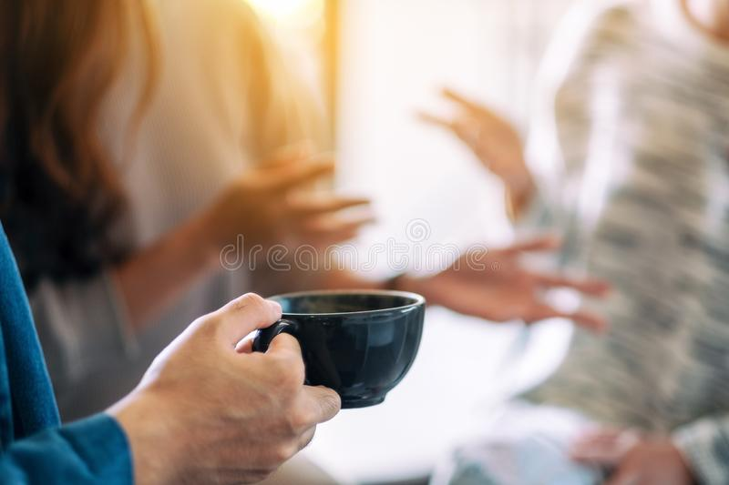 People enjoyed talking and drinking coffee together royalty free stock photo