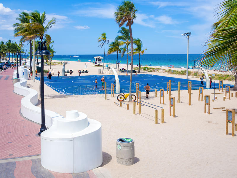 People enjoying the beach at Fort Lauderdale in Florida. FORT LAUDERDALE, USA - AUGUST 11, 2015 : People enjoying the beach at Fort Lauderdale in Florida on a royalty free stock photo