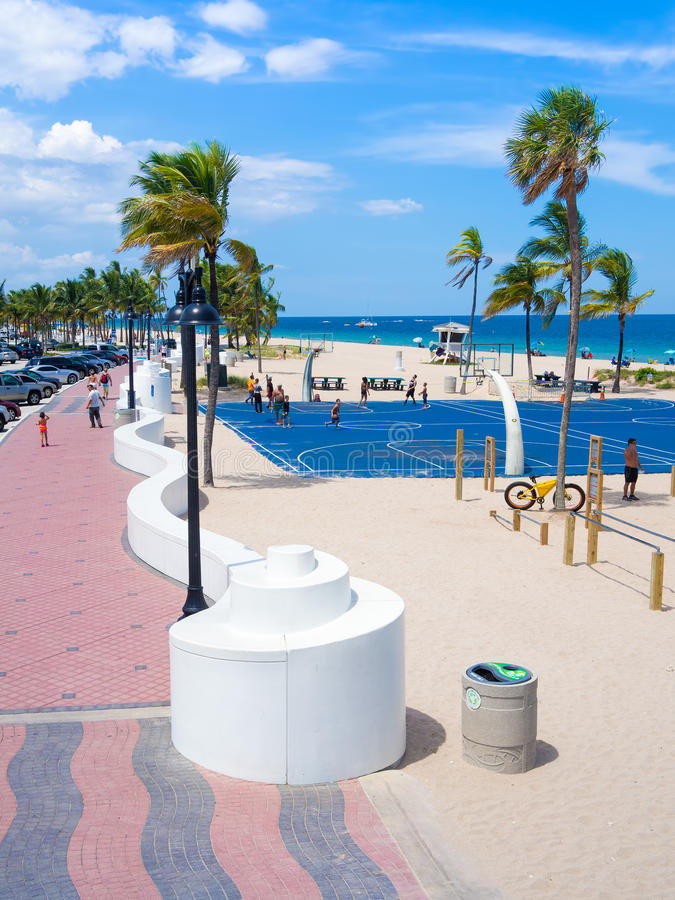 People enjoying the beach at Fort Lauderdale in Florida. FORT LAUDERDALE,USA - AUGUST 11,2015 : People enjoying the beach at Fort Lauderdale in Florida on a stock photos
