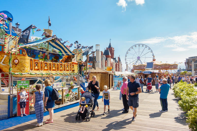 People Enjoying the Cardiff Bay Beach Festival 2017. Cardiff, United Kingdom - August 26, 2017: People enjoying themselves on a sunny day at the Cardiff Bay stock photo
