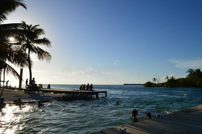 People Enjoying a Caribbean Sunset, Split, Caye Caulker, Belize stock images