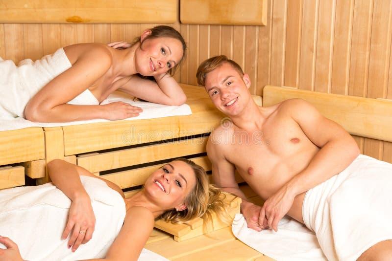 People enjoying a day in wellness sauna royalty free stock photo