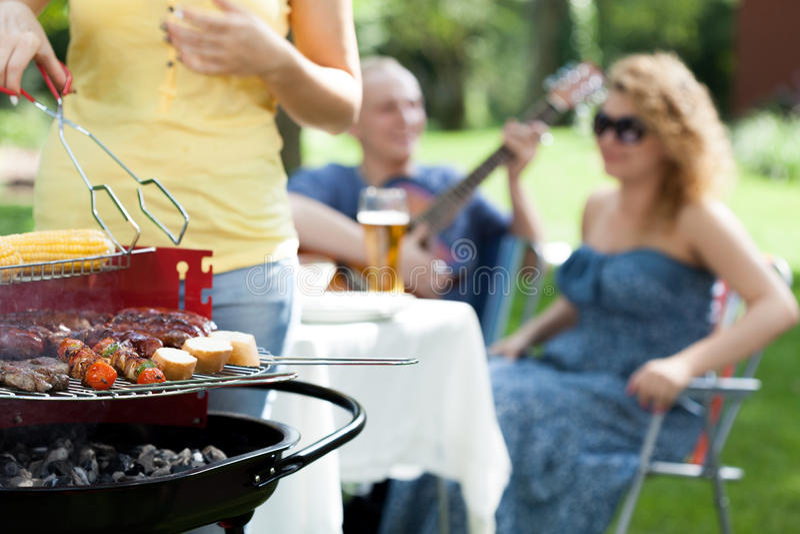 People enjoying on garden party stock photo