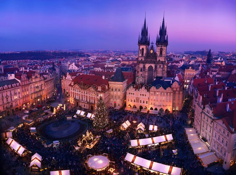 People enjoying holiday season at Christmas market on old european city royalty free stock image
