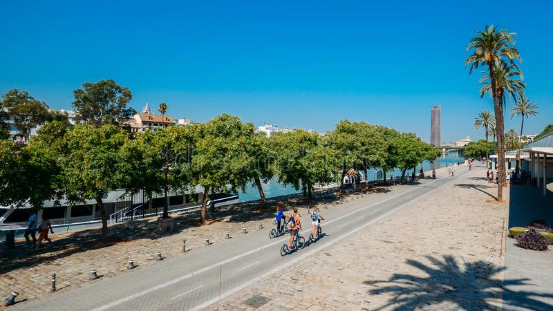 People enjoying leisure activities by Guadalquivir river, Seville, Spain. Seville, Spain - Sept 9, 2019: People enjoying leisure activities by Guadalquivir river stock photos
