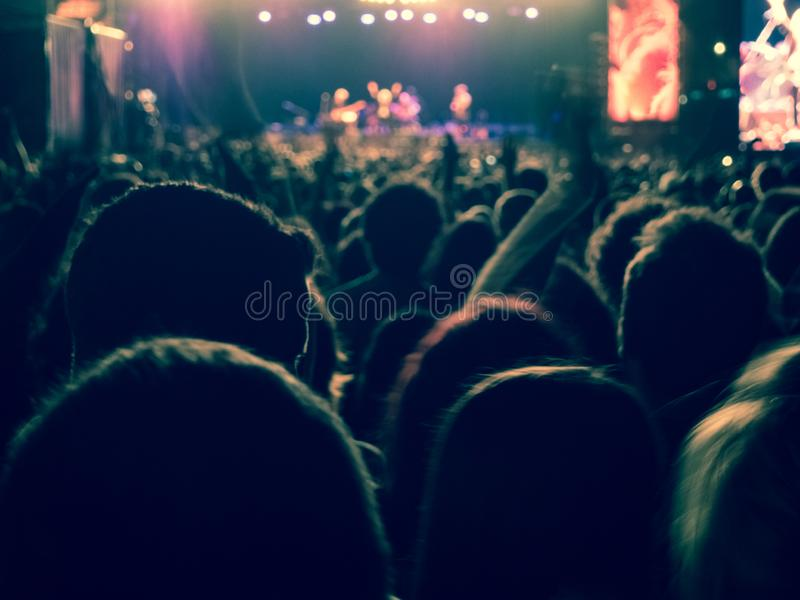 People enjoying of a music concert outdoors. At the night royalty free stock images