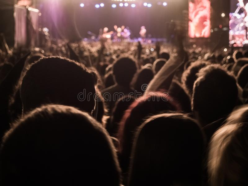 People enjoying of a music concert at the night stock photography