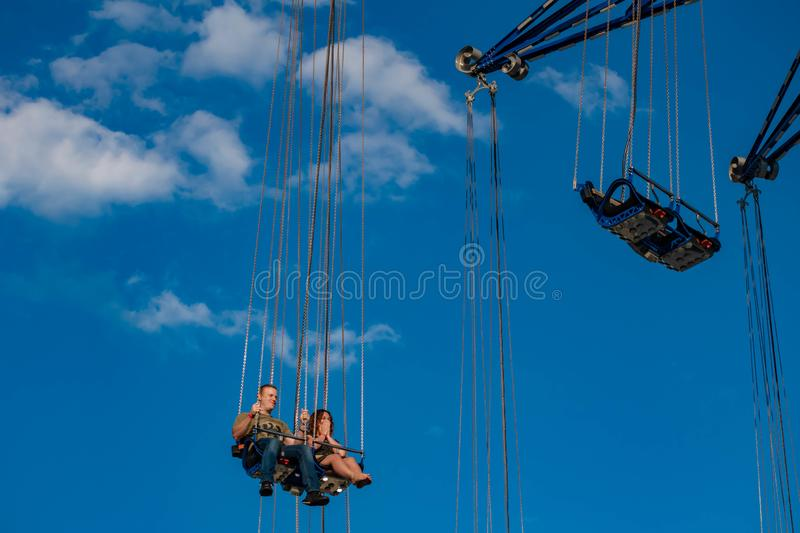 """People enjoying Orlando Star Flyer. It is the """"world's tallest swing ride standing at 450 feet.  in International Drive area. Orlando, Florida. May stock photography"""