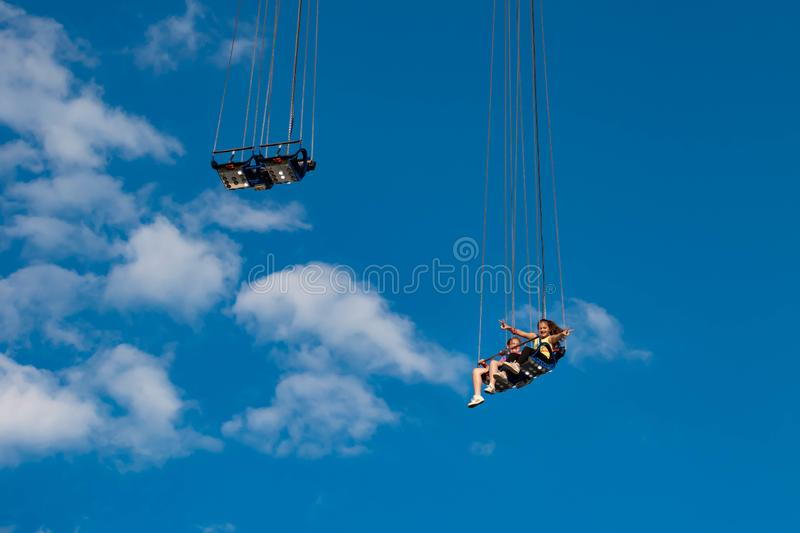 """People enjoying Orlando Star Flyer. It is the """"world's tallest swing ride standing at 450 feet.  in International Drive area. Orlando, Florida. May royalty free stock photography"""