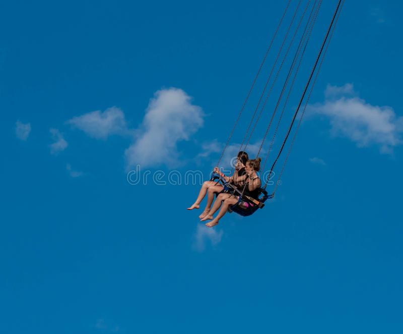 """People enjoying Orlando Star Flyer. It is the """"world's tallest swing ride standing at 450 feet.  in International Drive area royalty free stock photos"""