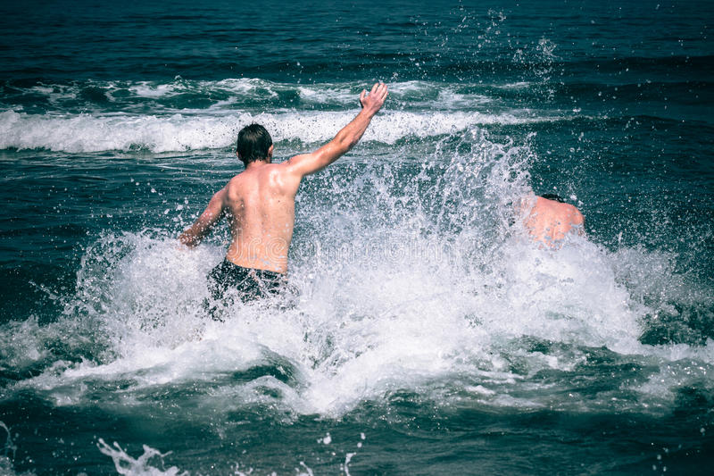 People enjoying sea stock photo