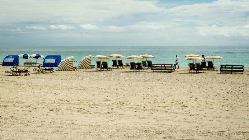 People enjoying South Beach Lounge Chairs and Umbrellas in Miami stock image