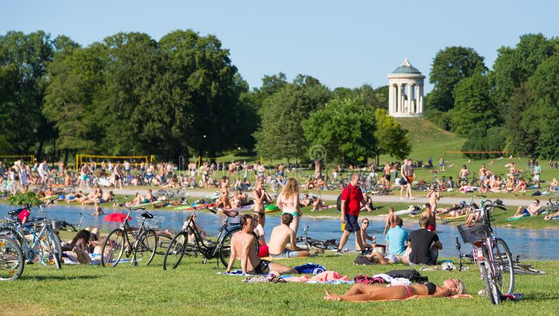 people enjoying the summer day in englischer garten city park in munich germany editorial. Black Bedroom Furniture Sets. Home Design Ideas