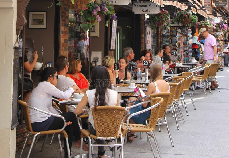 People enjoy at a cosy terrace in London Court, Perth, Australia. People are enjoying the weekend at a terrace in London Court between Hay Street and St Georges royalty free stock photo