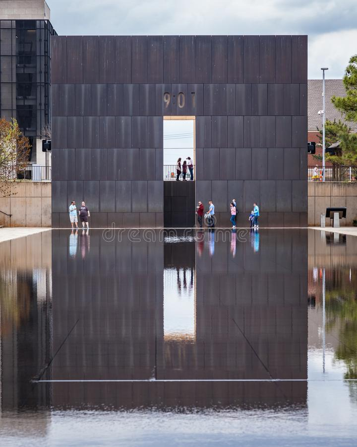 People Enjoying a visit to OKC Bombing Memorial. OKLAHOMA CITY, OKLAHOMA / USA - MARCH 31, 2018: People walking around and visiting the OKC Bombing Memorial and royalty free stock photo
