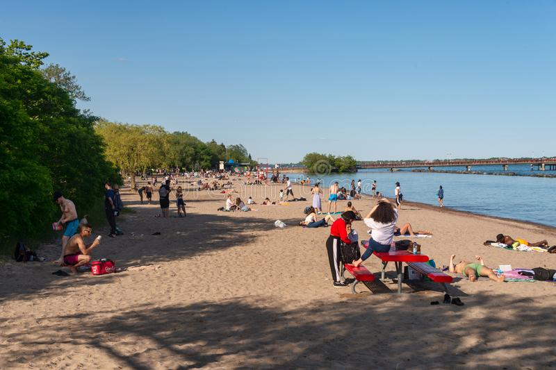 People enjoying a warm summer day at the beach on Centre island in Toronto 2019 royalty free stock images