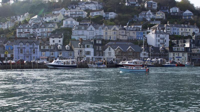 People enjoying warmer than average catching the Looe ferry to West Looe royalty free stock photo