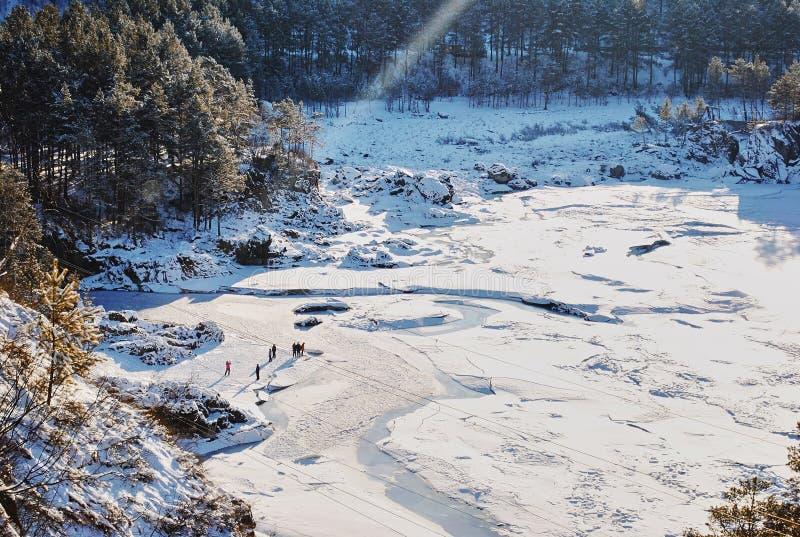 People enjoying winter nature landscape. Peoplet enjoying winter nature landscape in Altai Mountains, Siberia, Russia royalty free stock photography