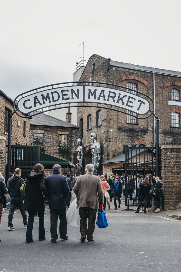 People entering Camden Market, London, UK, through the gates, under a name sign royalty free stock images