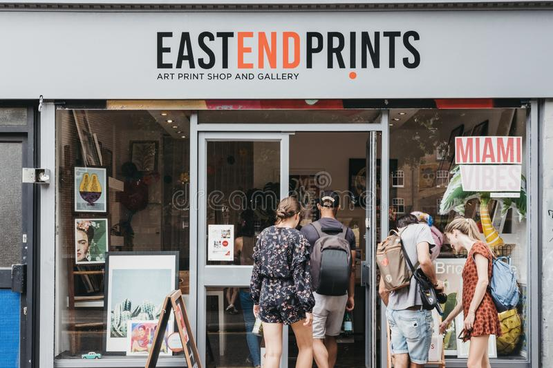 People entering East End Prints shop in East London, UK. royalty free stock photos