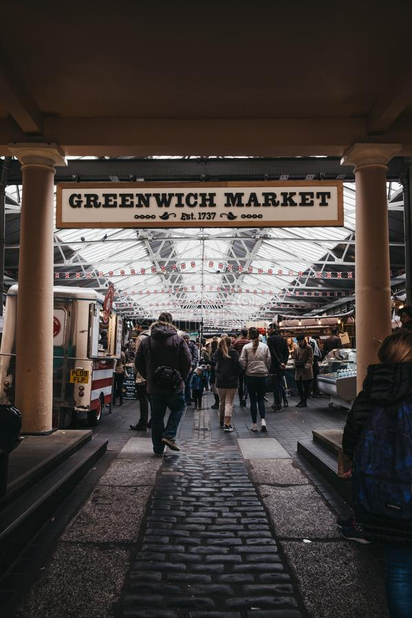 People entering Greenwich Market, London`s only market set within a World Heritage Site royalty free stock image