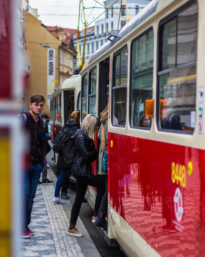 People entering tram stock photos