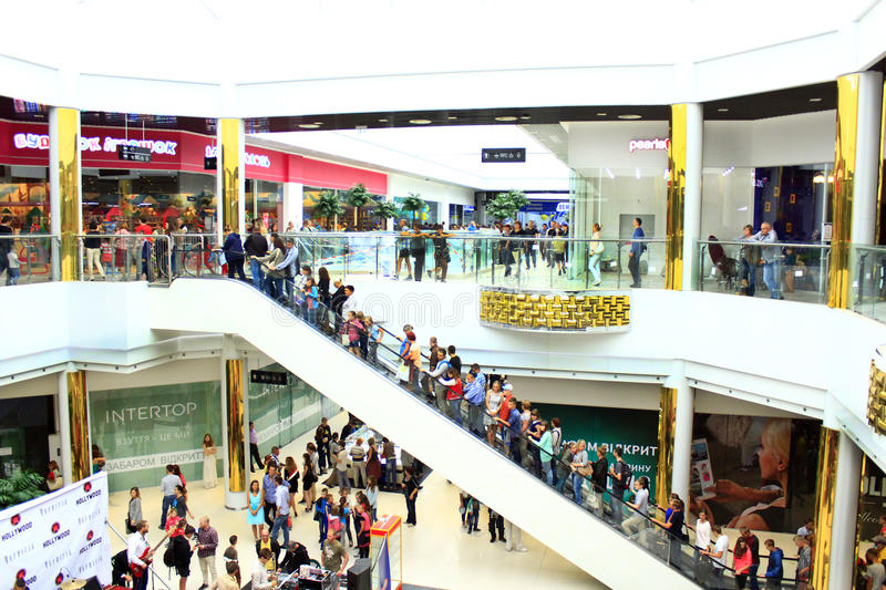 People on the escalator in the hypermarket royalty free stock photos