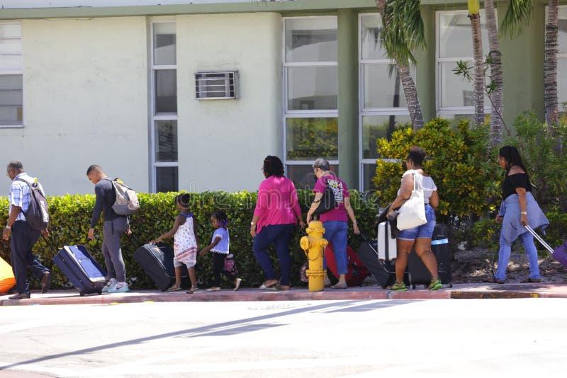 People evacuating Miami Beach Hurricane Irma stock photos