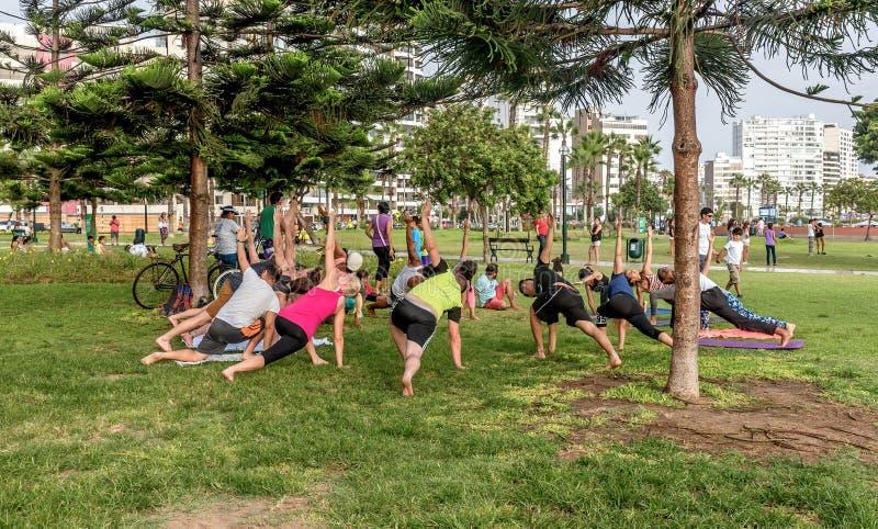 People exercising in El Parque del Amor, Lovers Park, Miraflores, Lima, Peru. Lima, Peru- March 12, 2017: People exercising in El Parque del Amor, Lovers Park royalty free stock image